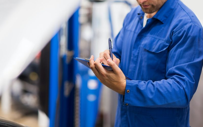 auto-mechanic-with-clipboard-at-car-repair-shop.jpg